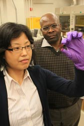 Sam Jenekhe and student examine solar cell